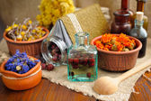 Healing herbs and tinctures in bottles on sackcloth, dried  flowers, herbal medicine — Stock Photo