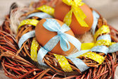 Easter eggs in the nest on a linen fabric — Stock Photo