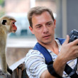 Photographer shows a monkey photo shoot — Stock Photo #58821755