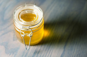 Jar of honey on a wooden table  — Stock Photo