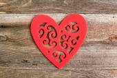 Red felt floral heart on reclaimed wood, valentines day backgrou — Stock Photo