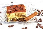 Tiramisu Cake with coffee beans and cinnamon — Stock Photo