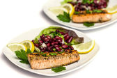 Salmon fillet grilled with bean salad, lemon and parsley isolated on white — Stock Photo