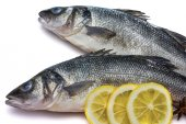 Sea bass fish whit lemon and star anise on withe background — Stock Photo