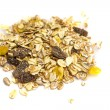 Heap of muesli isolated on white. Delicious granola cereal mix, with dried fruit and seeds. — Stock Photo #69932471