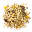 Heap of muesli isolated on white. Delicious granola cereal mix, with dried fruit and seeds. — Stock Photo #69932503
