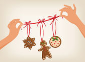 Hands holding a Christmas garland with cookies — Stock Vector
