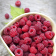 Raspberry in bowl in the form of heart — Stock Photo #54973357