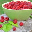 Fresh raspberry in green bowl — Stock Photo #56013095