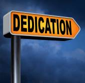 Dedication motivation sign — Stock Photo