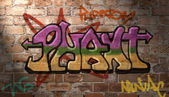 Grafitti writing on brick wall — Стоковое фото