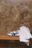 Joggers and towel in a change room  — Stock Photo