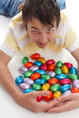 Boy gathering together easter eggs — Stock Photo