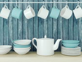 Ceramic kitchenware on the shelf. — Stock Photo