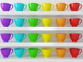 Rainbow cups on the shelfs. — Photo