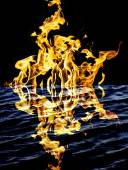 Flame fire with reflection in water — Foto Stock