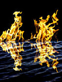 Flame fire with reflection in water — Stock Photo