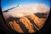 View from an airplane above clouds going home — Stock Photo