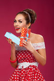 Happy Woman Holding Gift Box. Pin-up retro style. — Stock Photo
