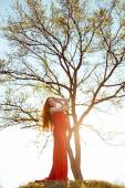 Young  pregnant woman relaxing and enjoying life in nature. Family tree. — Stock Photo