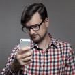 Handsome hipster modern man self shooting on smartphone camera. — Stock Photo #55379477