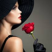 Beautiful Woman With Red Rose. Retro Fashion Image. — Stock fotografie