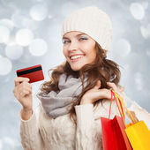 Shopping happy woman holding bags and credit card. Winter sales. — Foto Stock