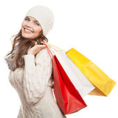 Shopping happy woman holding bags. Winter sales. — Stock Photo