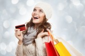 Shopping happy woman holding bags and credit card. Winter sales. — Stock Photo