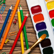 Back to school concept on wooden table. Watercolor paints and co — Stock Photo #57377923