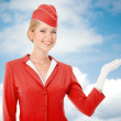 Charming Stewardess Dressed In Red Uniform Holding In Hand. Sky — Stock Photo #57569829