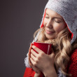 Beautiful blonde woman with an aromatic hot coffee in hands. — Stock Photo #62777519