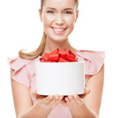 Young happy smiling woman with a gift in hands. Focus on the gif — Stock Photo