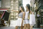 Two young girls doing shopping — Stok fotoğraf