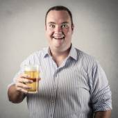 Man holding a glass of beer and looking happy — Stock Photo
