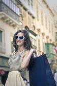 Beautiful girl smiling while doing shopping — Foto de Stock