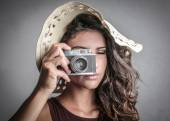 Beautiful woman taking a picture with her old-fashioned camera — Stock Photo