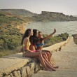 Three girls taking a selfie at the seaside — Stock Photo #54189701