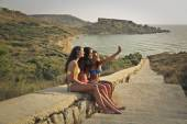 Three girls taking a selfie at the seaside — Stock Photo