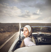 Beauty in a vintage car — Stock Photo