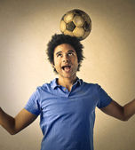 Boy with a soccer ball — Stock Photo