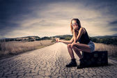 Hitchhiking girl — Stock Photo