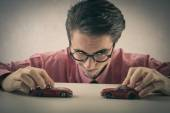 Businessman playing with cars — Foto de Stock