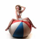 Sitting on a huge colourful ball — Stock Photo