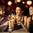 Three friends drinking a glass of wine together — Stock Photo #79723078
