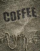 黄麻布の袋のコーヒー豆 — ストック写真
