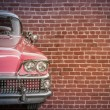 Classic Car Against Red Brick Wall — Stock Photo #54663523