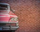 Classic Car Against Red Brick Wall — Stock Photo