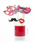 Photo Booth Props in a Red Mug — Stock Photo