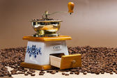 Coffee mill with coffee beans — Stock Photo
